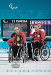 Ina Forrest, Dennis Thiessen, and Mark Ideson, Sochi 2014 - Wheelchair Curling // Curling en fauteuil roulant.<br /> Canada takes on Russia during round robin play // Le Canada affronte la Russie lors du tournoi à la ronde. 08/03/2014.