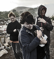 Oct, 2007, Easter Island, Chile. Same turist with are recollecting lonly dog in the rubbish dump. After 5 days as a tourist, photographer Lorenzo Moscia set to discover the real life of one of the more surprising places of the World, mix of cultures between Oceania and Latin America, with a native population near extintion./