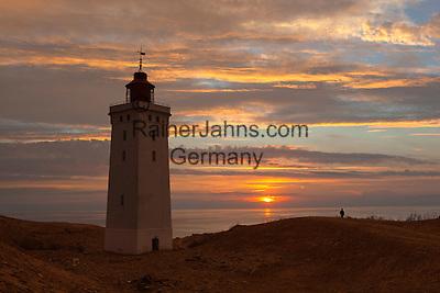 Denmark, Jutland, near Løkken: Rubjerg Knude Fyr (lighthouse), partly submerged by sand drifts, at sunset   Daenemark, Juetland, bei Løkken: Rubjerg Knude Fyr Leuchtturm bei Sonnenuntergang