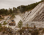 October 8, 2019. Cary, North Carolina.<br /> <br /> A front loader makes its way down the road into the pit of<br /> the Wake Stone Corp. Triangle Quarry. Wake Stone has a contract in place with the RDU Airport Authority to expand the quarry onto their land, but it is being challenged in court by multiple parties trying to halt the expansion in hopes of using the land for outdoor recreation. <br /> <br /> The proposed expansion of a Wake Stone Corp. granite aggregate quarry onto land owned by the Raleigh-Durham International Airport, which also borders Umstead State Park, has ignited a debate about what to do with unused public land and brought to the surface the conflict between recreation and the residential growth of the area. <br /> <br /> Jeremy M. Lange for The Wall Street Journal