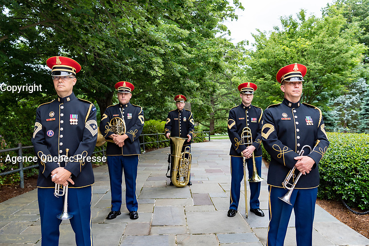 """The U.S. Army Band, """"Pershing's Own"""", prepares to march out as part of the National Memorial Day Observance at Arlington National Cemetery, Arlington, Virginia, May 25, 2020. This was the 152nd Memorial Day wreath-laying and observance ceremony at Arlington National Cemetery. (U.S. Army photo by Elizabeth Fraser / Arlington National Cemetery / released)"""