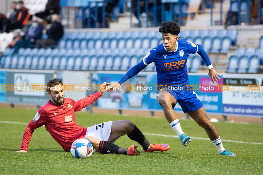 Courtney Senior, Colchester United evades the challenge from Adam Phillips of Morecambe during Colchester United vs Morecambe, Sky Bet EFL League 2 Football at the JobServe Community Stadium on 19th December 2020