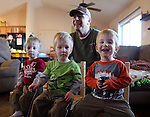 """Bill inman with his identical triplet grandsons from left, Brice, Elliott, and Cooper at Bill's son's home in December. January 30th the boys will be celebrating their 2ns birthdays. """"It's wonderful place to raise my kids and their kids."""" Michael Smith/staff"""