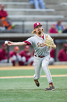 Florida State Seminoles relief pitcher Gage Smith (19) makes a throw to first base against the Wake Forest Demon Deacons at Wake Forest Baseball Park on April 19, 2014 in Winston-Salem, North Carolina.  The Seminoles defeated the Demon Deacons 4-3 in 13 innings.  (Brian Westerholt/Four Seam Images)