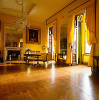 Curtains, pelmets and walls of yellow silk infuse the first floor drawing room of the Sir John Soane Museum in London's Lincoln's Inn Fields with a sunny golden glow
