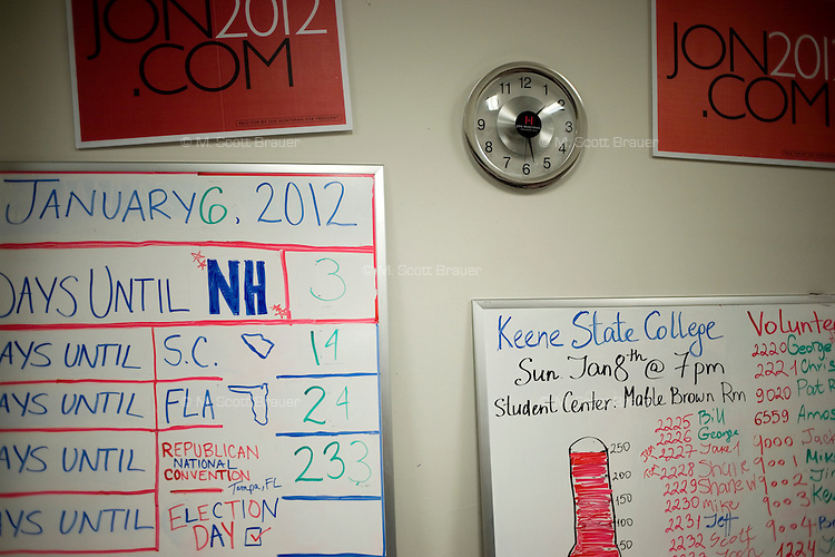 Date countdowns, organizational counts, and campaign materials hang on a wall at the Jon Huntsman New Hampshire campaign headquarters in Manchester, New Hampshire, on Jan. 7, 2012.  Huntsman is seeking the 2012 Republican presidential nomination.