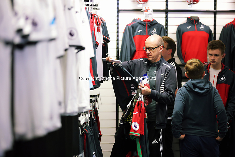 Pictured: Shoppers in the store. Saturday 01 July 2017<br /> Re: The new 2017-2018 season, Swansea City FC kit has officially gone on sale at the club's Liberty Stadium shop, Wales, UK