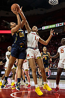 COLLEGE PARK, MD - DECEMBER 28: Shakira Austin #1 of Maryland defends against Naz Hillmon #00 of Michigan. during a game between University of Michigan and University of Maryland at Xfinity Center on December 28, 2019 in College Park, Maryland.