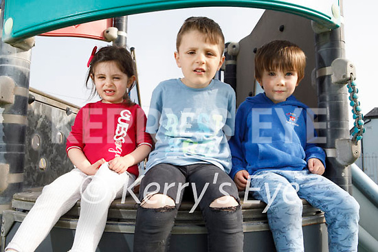 Enjoying the playground in Ballyheigue on Thursday, l to r: Lorna and Eric Mustaffa  and Jack Carroll.
