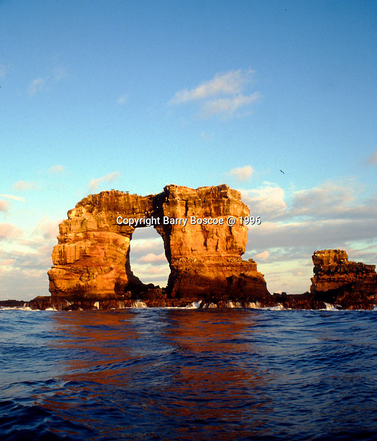 Darwin's Arch is a spectacular natural rock arch that rises above the ocean offshore of Darwin Island in the Galapagos Archipelago.