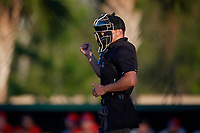 Umpire Kelvis Velez calls a strike during a Florida State League game between the Dunedin Blue Jays and Clearwater Threshers on May 11, 2019 at Jack Russell Memorial Stadium in Clearwater, Florida.  Clearwater defeated Dunedin 9-3.  (Mike Janes/Four Seam Images)
