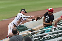 Salt River Rafters second baseman Travis Blankenhorn (5), of the Minnesota Twins organization, makes a catch before falling into the stands during an Arizona Fall League game against the Surprise Saguaros at Salt River Fields at Talking Stick on October 23, 2018 in Scottsdale, Arizona. Salt River defeated Surprise 7-5 . (Zachary Lucy/Four Seam Images)
