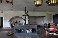 The vast kitchen, paved with a stone flagged floor still retains its original 18th century table
