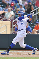 Paulo Orlando #16 of the Omaha Storm Chasers swings against the Las Vegas 51s at Werner Park on August 17, 2014 in Omaha, Nebraska. The Storm Chasers  won 4-0.   (Dennis Hubbard/Four Seam Images)