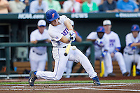 Florida Gators outfielder Harrison Bader (8) swings the bat against the Miami Hurricanes in the NCAA College World Series on June 13, 2015 at TD Ameritrade Park in Omaha, Nebraska. Florida defeated Miami 15-3. (Andrew Woolley/Four Seam Images)