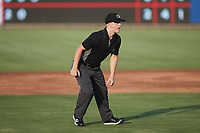 Umpire Matt Blackborow handles the calls on the bases during the game between the Charleston RiverDogs and the Kannapolis Cannon Ballers at Atrium Health Ballpark on June 29, 2021 in Kannapolis, North Carolina. (Brian Westerholt/Four Seam Images)