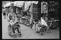 A vendor reads newspaper as he waits for customers at an antique market in Shanghai, China, August, 2012. (Leica M6, 50mm f2, Kodak TRI-X 400)