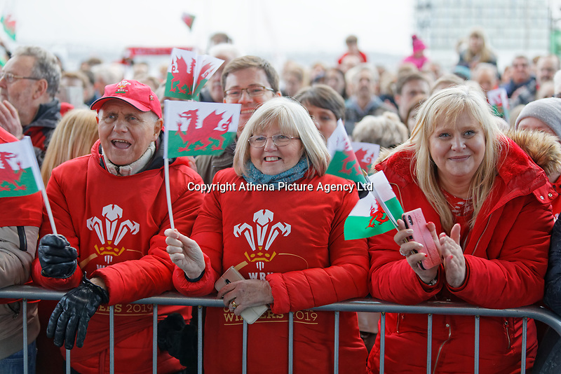 Rugby fans wave flags during the Celebration for Wales Six Nations Win at the National Assembly for Wales, Cardiff Bay, Wales, UK. Monday 18 March 2019