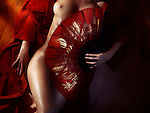 Beautiful naked woman body in red kimono covered with an oriental fan, fine art nude zen artistic concept Image © MaximImages, License at https://www.maximimages.com