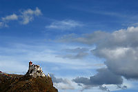 Tibet, the images from the Book Journey Through Color and Time, This Tebetan Monastery is perched high on a cliff.