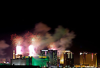 Fireworks explode over the Las Vegas strip on New Year's Eve January 1, 2014.  Over 300,000 visitors lined Las Vegas Blvd. over a 5 mile stretch to enjoy fireworks launched from 7 different hotel properties to welcome in the New Year.  The display by Fireworks by Grucci, is slated to include more than 80,000 pyrotechnic effects that will last more than eight minutes. (Photo John Gurzinski/lasvegasphotography.com)