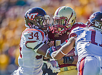 2 November 2013: Boston College Eagles running back Andre Williams (44) is stopped by Virginia Tech Hokies safety Kyshoen Jarrett (34) in the first quarter at Alumni Stadium in Chestnut Hill, MA. Mandatory Credit: Ed Wolfstein-USA TODAY Sports *** RAW (NEF) Image File Available ***