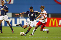 Claudio Reyna cuts the ball back. The USA lost 3-1 against Poland in the FIFA World Cup 2002 in Korea on June 14, 2002.