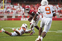 Arkansas wide receiver Treylon Burks (16) completes a pass, Saturday, September 11, 2021 during the first quarter of a football game at Reynolds Razorback Stadium in Fayetteville. Check out nwaonline.com/210912Daily/ for today's photo gallery. <br /> (NWA Democrat-Gazette/Charlie Kaijo)