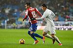 Real Madrid's player James Rodriguez and Sporting de Gijon's player isma during match of La Liga between Real Madrid and Sporting de Gijon at Santiago Bernabeu Stadium in Madrid, Spain. November 26, 2016. (ALTERPHOTOS/BorjaB.Hojas)