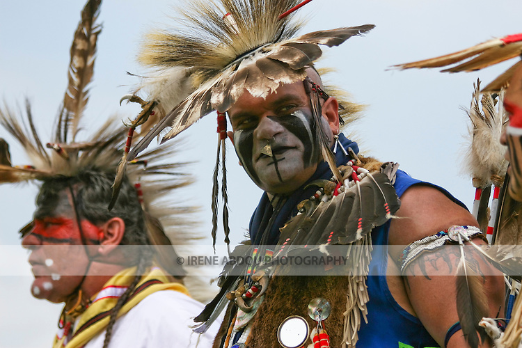 Keith Anderson (center) dances in full Native American regalia at the 8th Annual Red Wing PowWow in Red Wing Park, Virginia Beach, Virginia.