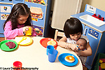 Education Preschool 3-4 year olds two girls playing with dolls pretend play feeding dolls, separately