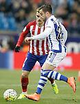Atletico de Madrid's Antoine Griezmann (l) and Real Sociedad's Hector Hernandez during La Liga match. March 1,2016. (ALTERPHOTOS/Acero)