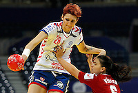 BELGRADE, SERBIA - DECEMBER 16:  Biljana Filipovic (L) of Serbia is challenged by Orsolya Verten (R) of Hungary during the Women's European Handball Championship 2012 third place match between Hungary and Serbia at Arena Hall on December 16, 2012 in Belgrade, Serbia. (Photo by Srdjan Stevanovic/Getty Images) ***Local Caption *** Biljana Filipovic;Orsolya Verten