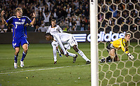 LA Galaxy forward Edson Buddle (14) and Kansas City Wizards goalkeeper Kevin Hartman (1) watch the ball drop in the back of the net as teammate Wizard defender Chance Myers (3) looks on in disbelief after Edson Buddle scores in the 73rd minute during the second half of a MLS match. The LA Galaxy defeated the Kansas City Wizards 3-1 at Home Depot Center stadium in Carson, Calif., on Saturday, May 24, 2008.