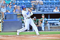 Asheville Tourists Yainer Diaz (16) swings at a pitch during a game against the Greensboro Grasshoppers on August 24, 2021 at McCormick Field in Asheville, NC. (Tony Farlow/Four Seam Images)