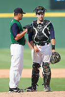 Catcher Donny Lucy #4 of the Charlotte Knights has a chat with relief pitcher Anthony Carter #30 during the 9th inning of the International League game against the Syracuse Chiefs at Knights Stadium on June 19, 2011 in Fort Mill, South Carolina.  The Knights defeated the Chiefs 10-9.    (Brian Westerholt / Four Seam Images)