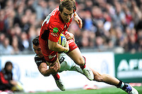 Chris Wyles of Saracens is tackled by George Lowe of Harlequins during the Aviva Premiership match between Saracens and Harlequins at Wembley Stadium on Saturday 31st March 2012 (Photo by Rob Munro)