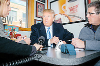 Republican presidential candidate Donald Trump speaks to reporters at the Red Arrow Diner in Manchester, New Hampshire.