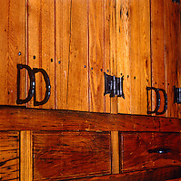 Reclaimed wood has been used to build kitchen cupboards and signs of wear and tear from its previous incarnation can still be seen despite being waxed to a golden brown
