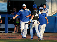 IMG Academy Ascenders coaches shake hands with Tommy White (34) during a game against the Jesuit Tigers on April 21, 2021 at IMG Academy in Bradenton, Florida.  (Mike Janes/Four Seam Images)