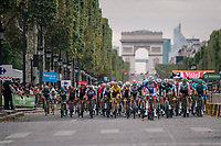 the peloton, with yellow jersey / GC leader Geraint Thomas (GBR/SKY) incapsulated in it, speeding down the famous Champs-Élysées with the Arc de Triomphe as a backdrop<br /> <br /> Stage 21: Houilles > Paris / Champs-Élysées (115km)<br /> <br /> 105th Tour de France 2018<br /> ©kramon