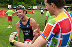 MIDDLEBURY, CT 070721JS16 Mens overall winner Owen Rowlands, left, shares a laugh with second place finisher Chris Solarz, right, after competing in the 35th annual Pat Griskuus Triathlon held Wednesday at Quassy Amusement Park in Middlebury.  <br /> Jim Shannon Republican American