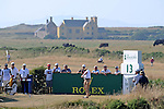 Miguel Angel Jiminez tees off on the 13th during day one of The Senior Open Golf Tournament at The Royal Porthcawl Golf Club in South Wales this afternoon.