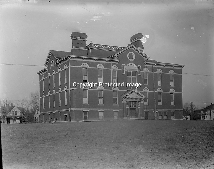 EVERETT ELEMENTARY SCHOOL. Everett Elementary School was built in 1887 at Eleventh and C Streets. Harrison Johnson built his house two blocks away in 1891 and presumably his son, John, attended school here<br /> <br /> Photographs taken on black and white glass negatives by African American photographer(s) John Johnson and Earl McWilliams from 1910 to 1925 in Lincoln, Nebraska. Douglas Keister has 280 5x7 glass negatives taken by these photographers. Larger scans available on request.