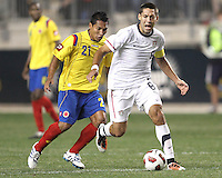 Clint Dempsey #8 of the USA MNT gets away from John Javier Restrepo #21 of Colombia during an international friendly match at PPL Park, on October 12 2010 in Chester, PA. The game ended in a 0-0 tie.