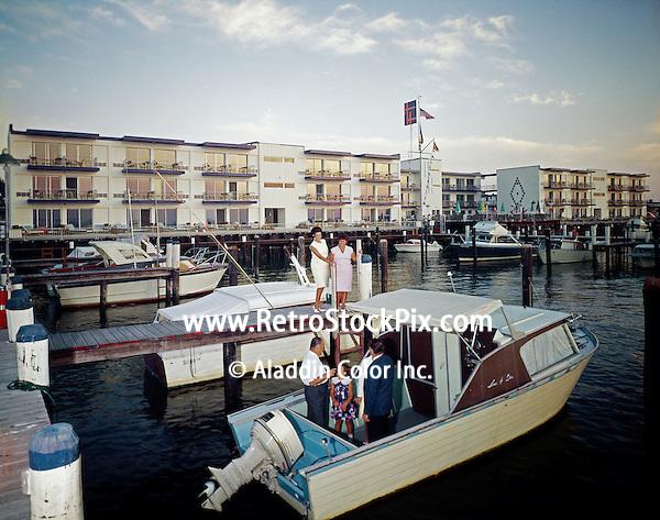 Harbor House Marina,Ocean City NJ. Couples meeting on a boat docked in the marina.
