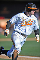Tennessee Volunteers second baseman Will Maddox #1 runs to first during a game against the UNLV Runnin' Rebels at Lindsey Nelson Stadium on February 22, 2014 in Knoxville, Tennessee. The Volunteers defeated the Rebels 5-4. (Tony Farlow/Four Seam Images)