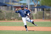 San Diego Padres third baseman Kelvin Melean (4) prepares to make a throw to first base during an Instructional League game against the Texas Rangers on September 20, 2017 at Peoria Sports Complex in Peoria, Arizona. (Zachary Lucy/Four Seam Images)