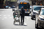 Dr. Barry Jacobson wheels an anesthesia machine from his dentist practice to Mount Sinai Hospital to help in the fight against the coronavirus pandemic on April 6, 2020 in New York City.  More than 10,000 people have died from COVID-19 in the U.S..  Photograph by Michael Nagle