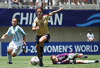 Chile, Chillan:Usa forward Alex Morgan goes for the ball along with Noelia Espindola and the golkeaper Guadalupe Calello during the football second match of the Fifa U-20 Women´s World Cup at Nelson Oyarzún stadium in Chillán , on November 22 2008. Photo by Grosnia/ISIphotos.com
